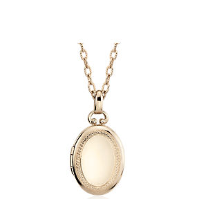 Oval locket in 14k yellow gold.