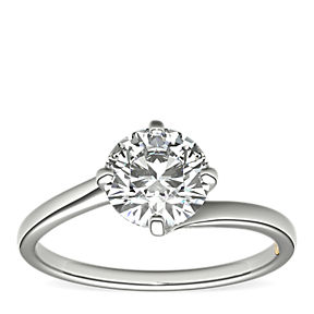 ZAC Zac Posen solitaire east-west engagement ring set with a round centre diamond in platinum.
