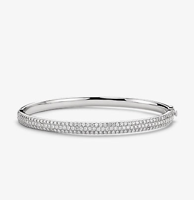Hinged bangle bracelet set with petite round diamonds in 18k white gold.