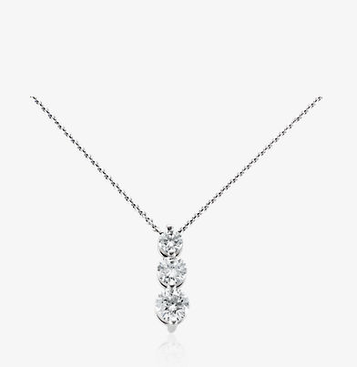 Drop pendant with three graduated-size diamonds in 18k white gold.