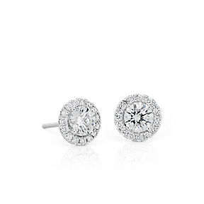 Diamond halo stud earrings in 14k white gold.