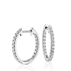 Pavé set diamond hoop earrings in 14k white gold.