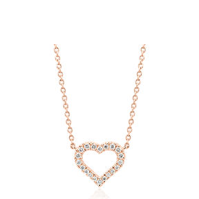 Mini diamond heart pendant in 14k rose gold.