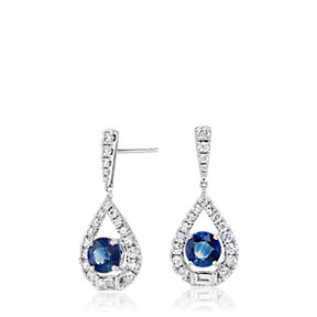 18k white gold teardrop earrings set with round sapphire center stones surrounded by round and baguette diamonds.