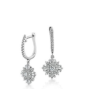 Drop earrings with a starburst of round and trapezoid diamonds in 14k white gold.