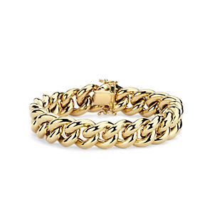 A yellow gold chain link bracelet.