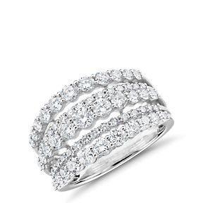 Diamond ring made up of 5 differently sized rows of round diamonds in 14k white gold.