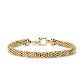 Tightly woven bracelet in 14k yellow gold.