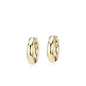 Classic mini hoop earrings in 14k yellow gold.