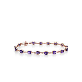 A delicate bracelet with claw-set oval amethyst gemstones connected by rose gold infinity shaped links.