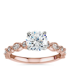 Monique Lhuillier round center diamond engagement ring with alternating round and maquise side diamonds in 18k rose gold.