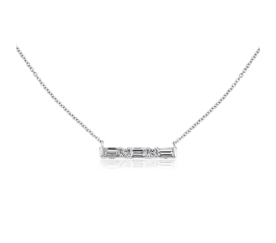 a white gold bar necklace set with alternating round and baguette diamonds