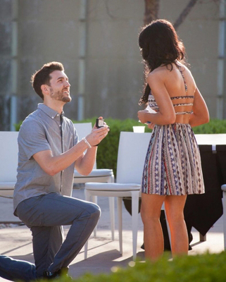 A true romantic: Wilson on bended knee proposing to Felicia
