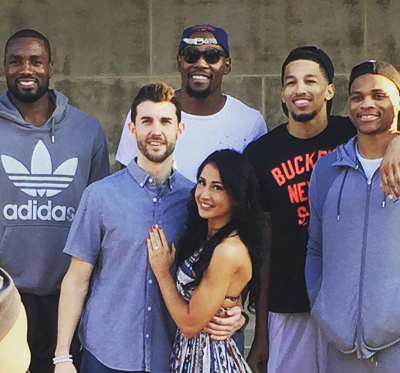 Wilson and Felicia with OKC Thunder team members