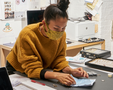 Designer Wing Yau in her studio looking at Botswana diamonds