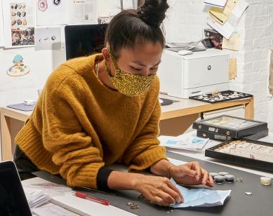 Designer Wing Yau in her studio looking at Botswana diamonds