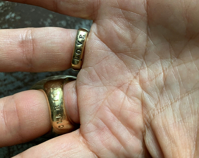 Mejia's ring hand-inscribed with LOVE