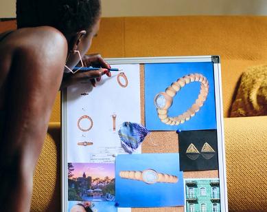 The designer working on her mood board for Ten/Ten