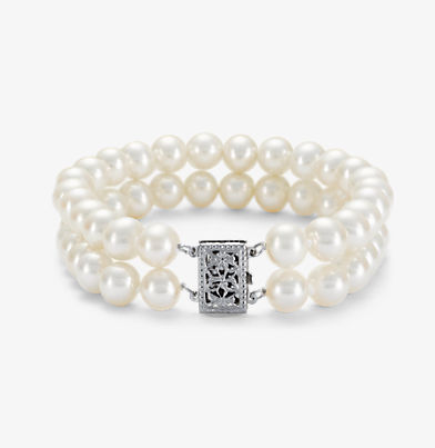 Freshwater cultured pearls set in two rows and with a 14k white gold filigree clasp.
