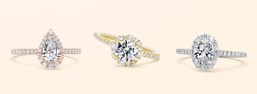两枚钻石订婚戒指和一枚金属结婚戒指