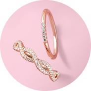 Deux bagues en or rose et diamants.