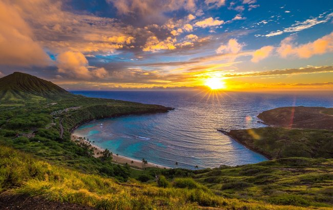 Golden sunsets contrast crystal blue waters.