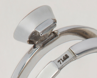 A detail shot of the clasp of Aaron's 'DiMe Siempre' ring for Ten/Ten.