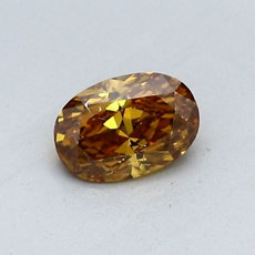 Diamant ovale 0,53 carat orange profond aux nuances brunes et jaunes