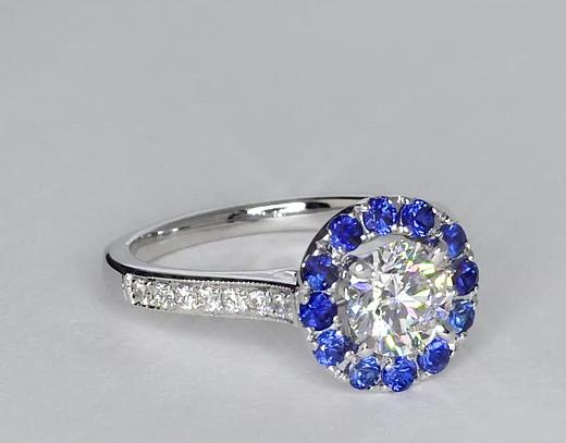0.86 Carat Halo Sapphire and Diamond Engagement Ring