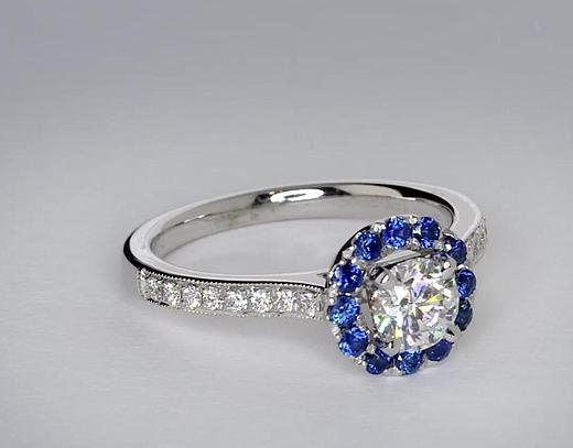 0.6 Carat Halo Sapphire and Diamond Engagement Ring