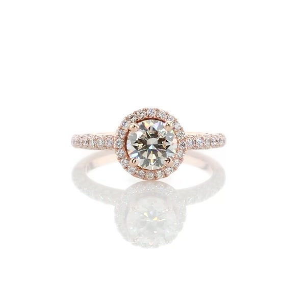 K color diamond in rose gold halo setting