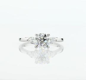 Pear Sidestone Diamond Engagement Ring in Platinum (1/4 ct. tw.)