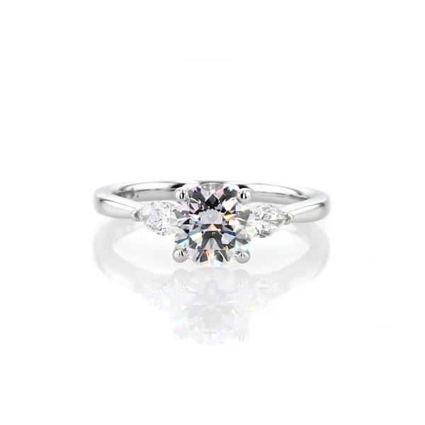 1.21 Carat Pear Sidestone Diamond Engagement Ring