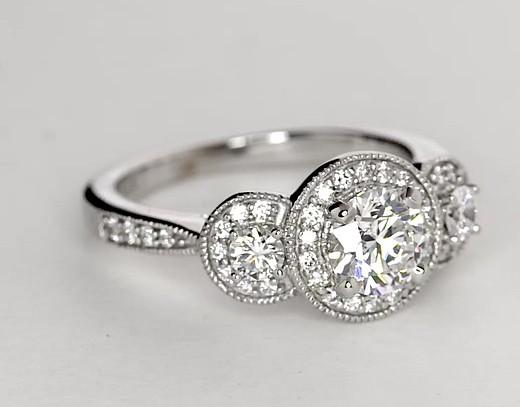 Bague de fiançailles trois pierres mille-grains halo de diamants en or blanc 14carats (1/2carat, poids total)